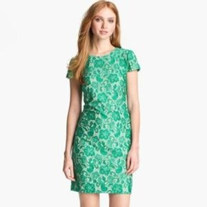 green lace shift with nude underlay